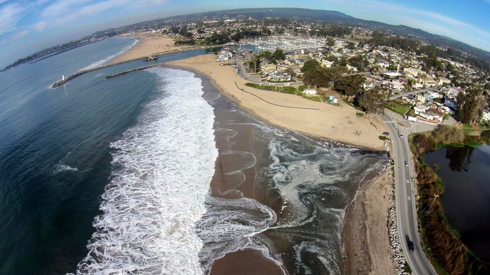 This January 20, 2015 photo provided by The Nature Conservancy shows Twin Lakes Beach in Santa Cruz, Calif. and Schwann Lagoon, the body of water on the right. (Matt Merrifield/The Nature Conservancy via AP)