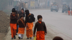 Pakistani students on their way to school in Charsadda, Pakistan, on Jan. 25, 2016. (Mohammad Sajjad / AP)