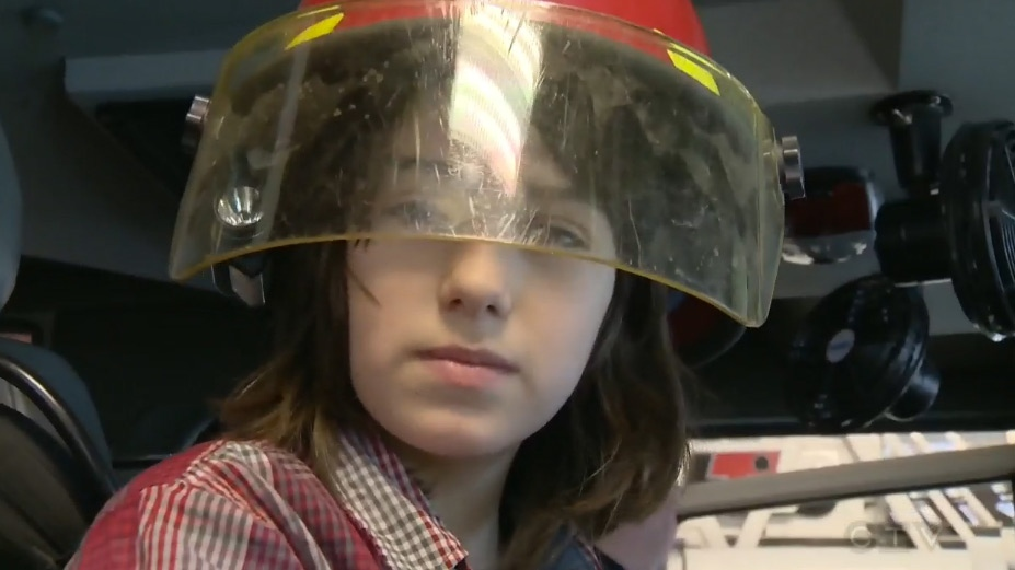 Nash Reid-Bancroft tries on a firefighter's helmet in Halifax on Sunday, Jan. 25, 2016.