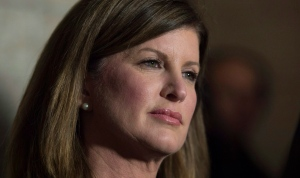 In this file photo, Interim Opposition Leader Rona Ambrose speaks with the media following question period on Tuesday December 8, 2015 in Ottawa. (Adrian Wyld/THE CANADIAN PRESS)