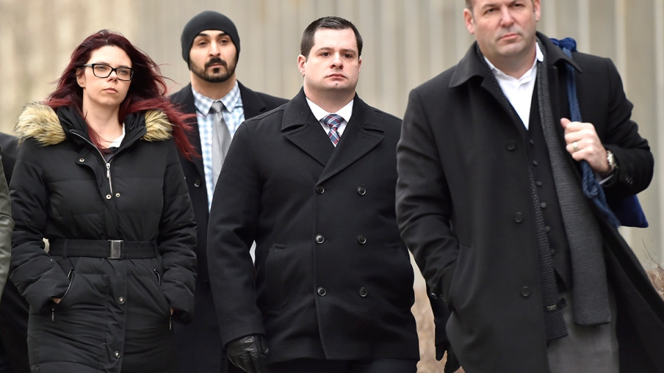 Const. James Forcillo, centre, and his wife Irina arrive for his verdict at court in Toronto on Monday, Jan. 25, 2016. (Nathan Denette / THE CANADIAN PRESS)