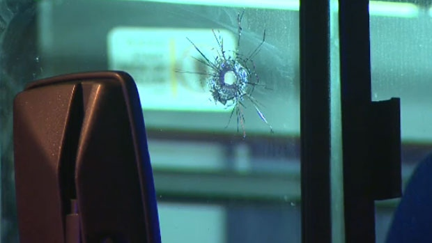 A single bullet hole is seen in the front window of a Calgary Transit bus. Police say the driver, who made the original call to 911, narrowly avoided injury.