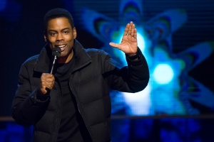 In this Feb. 28, 2015, file photo, Chris Rock appears onstage at Comedy Central's 'Night of Too Many Stars: America Comes Together for Autism Programs' at the Beacon Theatre in New York. (Charles Sykes/Invision/AP, File)