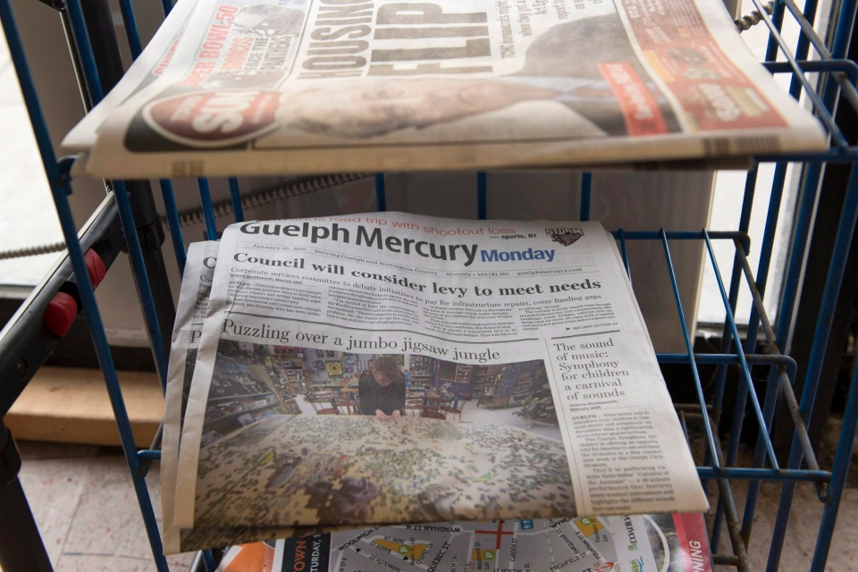 The Guelph Mercury papers sit in a convenience store in Guelph, Ont. on Monday, Jan. 25, 2016. (THE CANADIAN PRESS / Hannah Yoon)