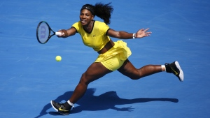 Serena Williams plays a forehand return to Maria Sharapova during their quarter-final match at the Australian Open tennis championships in Melbourne, Australia on Tuesday, Jan. 26, 2016. (AP / Vincent Thian)