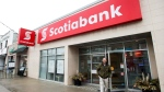 A man leaves Scotiabank in Toronto on Thursday, April 9, 2015. (Nathan Denette/THE CANADIAN PRESS)
