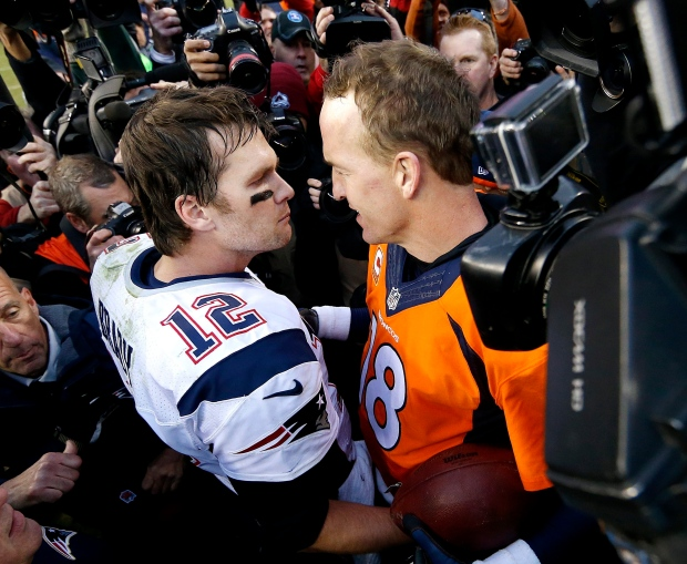 ... Patriots quarterback Tom Brady (12) and Denver Broncos quarterback  Peyton Manning speak to one another following the NFL football AFC  Championship game ... 459ef8d3d