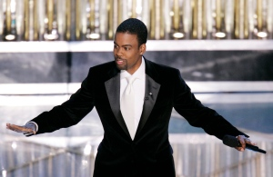 In this Feb. 27, 2005, file photo, Oscar Host Chris Rock performs his monologue to open the 77th Academy Awards telecast in Los Angeles. (Mark J. Terrill / AP Photo)