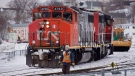 A CN locomotive moves in the railway yard in Dartmouth, N.S. on Monday, Feb. 23, 2015. (Andrew Vaughan / The Canadian Press)