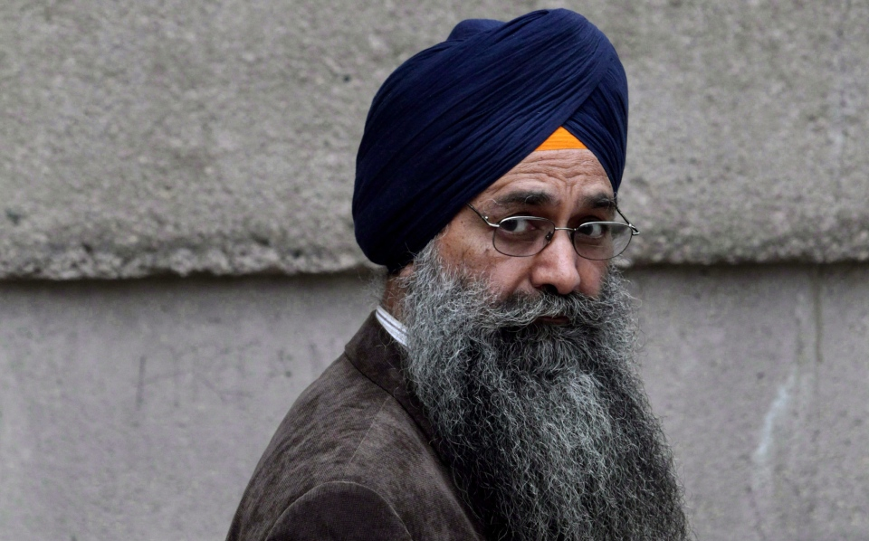 Inderjit Singh Reyat, waits outside B.C. Supreme Court in Vancouver on September 10, 2010.(Darryl Dyck / The Canadian Press)