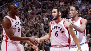 Toronto Raptors' DeMar DeRozan, right, and teammate Bismack Biyombo, left, congratulate teammate Cory Joseph following his buzzer-beating first-quarter basket during first half NBA basketball action, in Toronto, on Tuesday, Jan. 26, 2016. THE CANADIAN PRESS/Frank Gunn