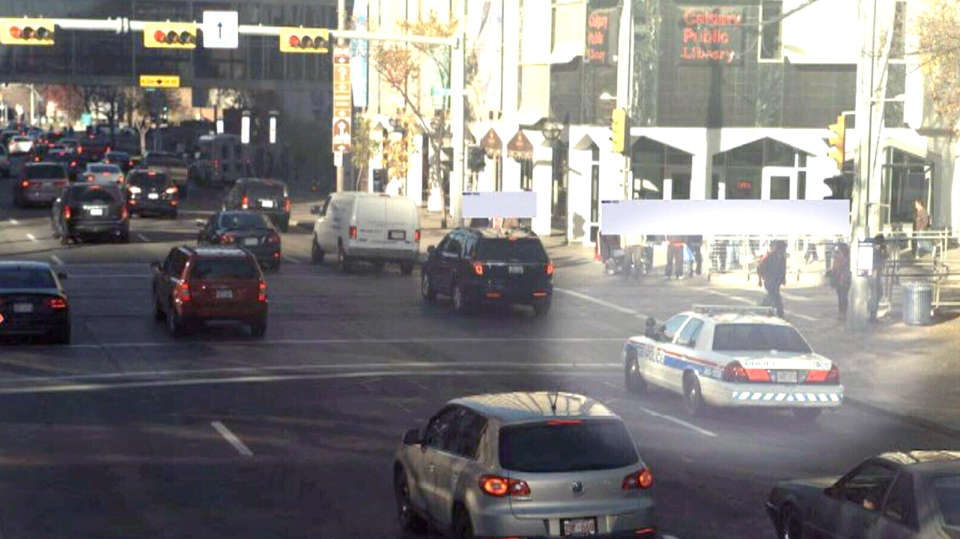 A Calgary Police Service vehicle is highlighted in this image from a traffic camera.