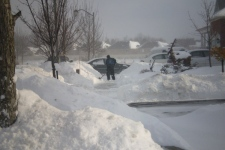 A man shovels his driveway in Caledon, Ont., on Sunday, Dec. 21, 2008, after a snowstorm hit overnight. (Sumran Bhan / CTV.ca)