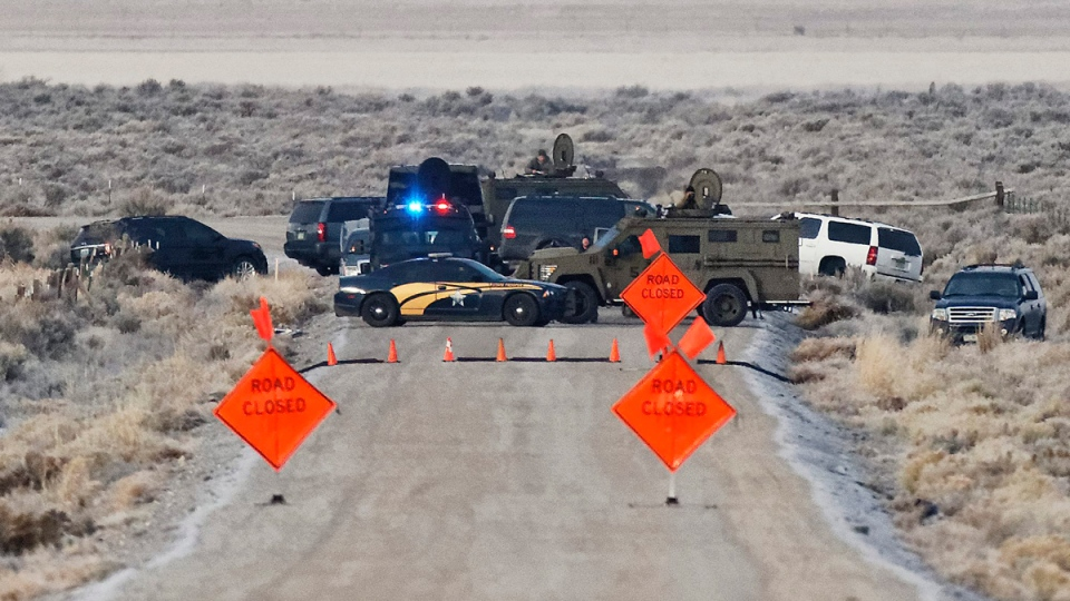 Law enforcement personnel block an access road to the Malheur National Wildlife Refuge, on Jan. 27, 2016. (Thomas Boyd/The Oregonian via AP)