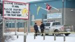 Members of the RCMP stand outside the La Loche Community School in La Loche, Sask. Monday, Jan. 25, 2016. THE CANADIAN PRESS/Jonathan Hayward
