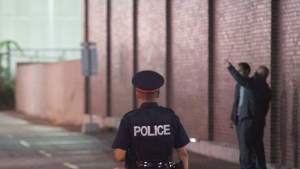 A Toronto police officer is pictured at an investigation in this file photo.  THE CANADIAN PRESS/Victor Biro