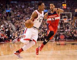 Toronto Raptors' DeMar DeRozan drives up the court as he's shadowed by Washington Wizards' Garrett Temple, right, during first half NBA basketball action, in Toronto, on Jan. 26, 2016. (Frank Gunn / The Canadian Press)