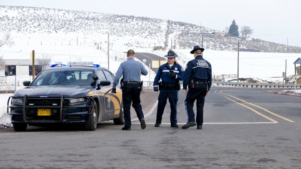 Oregon State Police man a roadblock at the intersection of highways 395 and 20 outside of Burns, Ore., Wednesday morning, Jan. 27, 2016. (Dave Killen / The Oregonian)