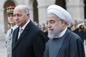 French Foreign Minister Laurent Fabius, left, and Iranian President Hassan Rouhani inspect the honour guard during a welcome ceremony at the Invalides in Paris, Thursday, Jan. 28, 2016. (AP Photo/Michel Euler, Pool)