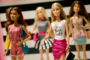 In this Sept. 29, 2015 file photo, Barbie Fashionista Dolls from Mattel are displayed at the TTPM Holiday Showcase in New York. (AP Photo/Mark Lennihan)