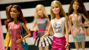 In this Sept. 29, 2015, file photo, Barbie Fashionista Dolls from Mattel are displayed at the TTPM Holiday Showcase in New York. Mattel Inc., the maker of the famous plastic Barbie doll, says it will start producing three separate body types of the doll. (AP/Mark Lennihan)