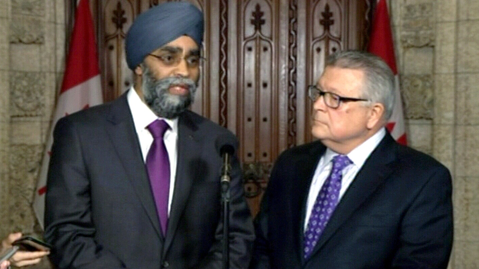 Public Safety Minister Ralph Goodale, right, and Defence Minister Harjit Sajjan speak about reports on the CSE and CSIS, in Ottawa, Thursday, Jan. 28, 2016.