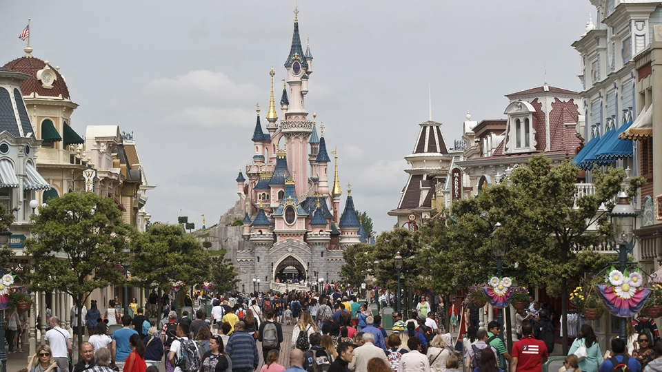 Visitors walking toward the Sleeping Beauty's Castle, background, at Disneyland Paris in Marne la Vallee, east of Paris, France, Tuesday, May 12, 2015. (AP / Michel Euler)