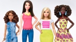 This photo provided by Mattel shows a group of new Barbie dolls introduced in January 2016. Mattel, the maker of the famous plastic doll, said it will start selling Barbie's in three new body types: tall, curvy and petite. (Mattel via AP)