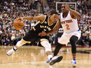 Toronto Raptors' Kyle Lowry (7) drives pass New York Knicks' Langston Galloway (2) during first half NBA basketball action in Toronto on Thursday, Jan. 28, 2016. (Frank Gunn / THE CANADIAN PRESS)