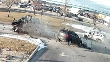 Surveillance camera video captures car crash