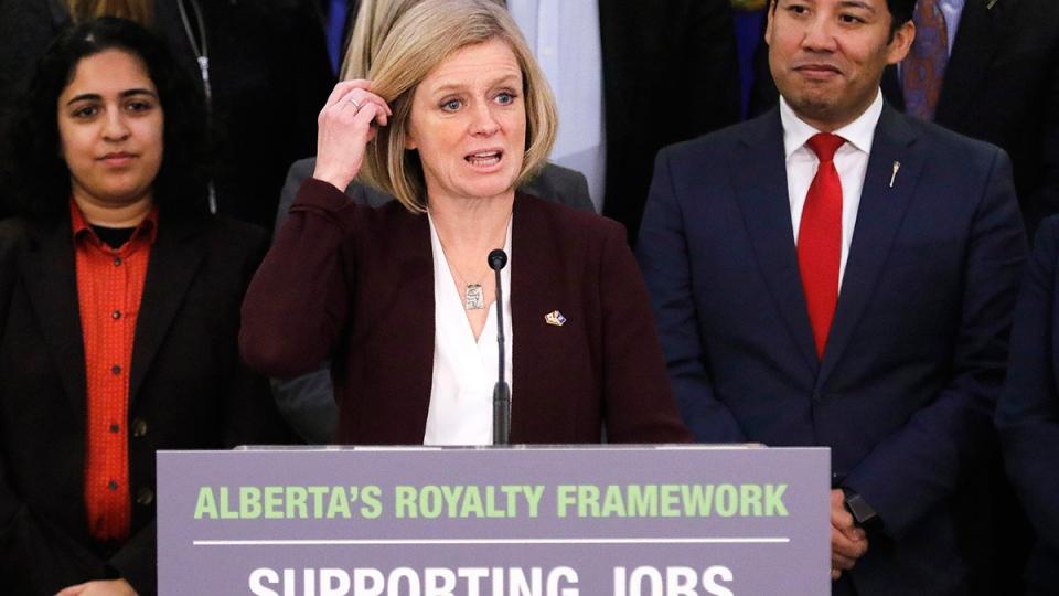 Surrounded by Calgary Caucus members, Alberta Premier Rachel Notley announces Alberta's New Royalty Framework in Calgary, on Friday, Jan. 29, 2016. (Larry MacDougal / THE CANADIAN PRESS)