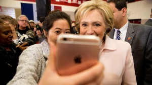 Democratic presidential hopeful Hillary Clinton takes a photograph in Des Moines, Iowa, on Friday, Jan. 29, 2016. (AP Photo/Andrew Harnik)