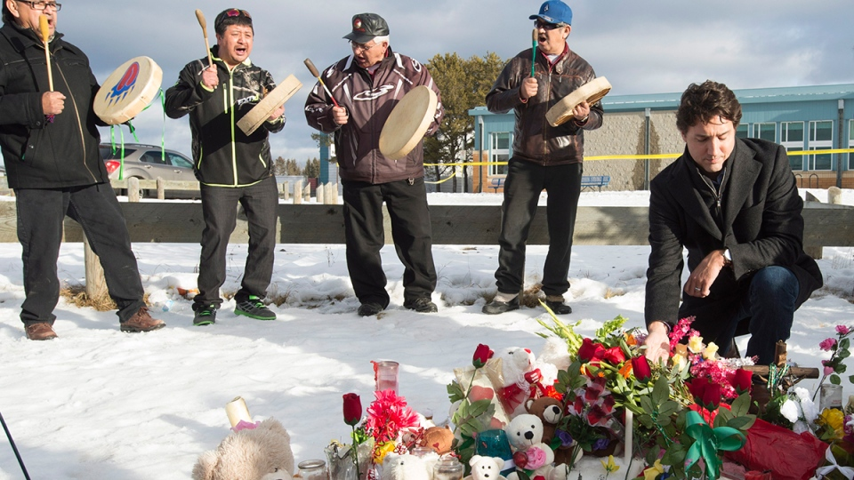 Prime Minister Justin Trudeau pauses for a moment as he lays a wreath outside the La Loche Community school in La Loche, Sask., Friday, Jan. 29, 2016. (Jonathan Hayward / THE CANADIAN PRESS)