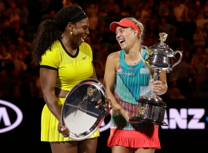 Angelique Kerber, right, of Germany holds the trophy with runner-up Serena Williams of the United States after winning their women's singles final at the Australian Open tennis championships in Melbourne, Australia, Saturday, Jan. 30, 2016.(AP/Aaron Favila)