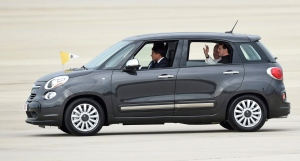 In this Sept. 22, 2015, file photo, Pope Francis waves from inside a Fiat 500 as he departs Andrews Air Force Base in Md. (AP/Susan Walsh)