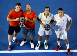 Jamie Murray, left, of Britain and Bruno Soares of Brazil pose with their trophy after defeating Daniel Nestor, right, of Canada and Radek Stepanek, second right, of the Czech Republic in the men's doubles final at the Australian Open tennis championships in Melbourne, Australia, early Sunday, Jan. 31, 2016.(AP/Vincent Thian)