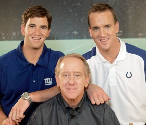 In this May 8, 2008, file photo, Archie Manning, center, is joined by his sons Eli Manning, left, and Peyton Manning after the taping of a commercial in Beverly Hills, Calif. (Reed Saxon / AP Photo)