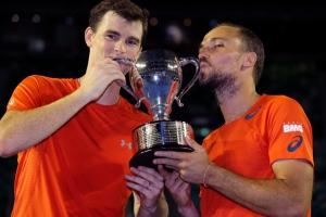 Jamie Murray, left, of Britain and Bruno Soares of Brazil hold their trophy after defeating Daniel Nestor of Canada and Radek Stepanek of the Czech Republic in the men's doubles final at the Australian Open tennis championships in Melbourne, Australia on Jan. 31, 2016.(Aaron Favila / AP Photo)