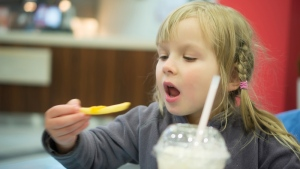 New UK research suggests that junk food advertising really does lead children to eat more. (Aleph Studio / shutterstock.com)