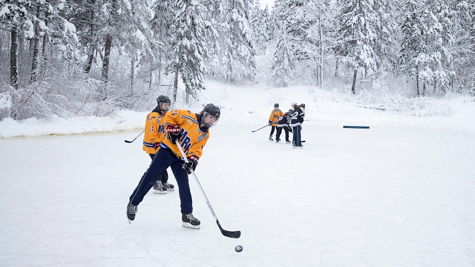 Hockey players warm up at the Long Pond Heritage Classic in Windsor, N.S. on Saturday, Jan. 30, 2016. Premier Stephen McNeil announced support of up to $3 million for the Windsor Hockey Heritage Centre. (THE CANADIAN PRESS / Andrew Vaughan)