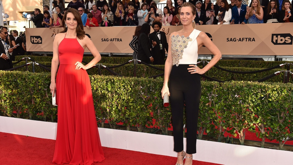 Tina Fey, left, and Kristen Wiig arrive at the 22nd annual Screen Actors Guild Awards at the Shrine Auditorium & Expo Hall on Saturday, Jan. 30, 2016, in Los Angeles. (Photo by Jordan Strauss / Invision / AP)