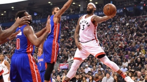 Toronto Raptors' James Johnson (3) makes a pass as Detroit Pistons' Anthony Tolliver, centre, and Andre Drummond (0) defend during first half NBA basketball action in Toronto on Saturday, Jan. 30, 2016. (THE CANADIAN PRESS / Frank Gunn)
