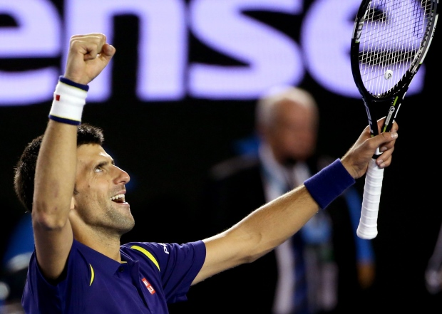 Novak Djokovic of Serbia celebrates after defeating Andy Murray of Britain in the men's singles final at the Australian Open tennis championships in Melbourne, Australia, Saturday, Jan. 30, 2016.(AP/Rick Rycroft)