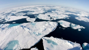 This July 10, 2008 file photo made with a fisheye lens shows ice floes in Baffin Bay above the Arctic Circle, seen from the Canadian Coast Guard icebreaker Louis S. St-Laurent. (AP / The Canadian Press, Jonathan Hayward)