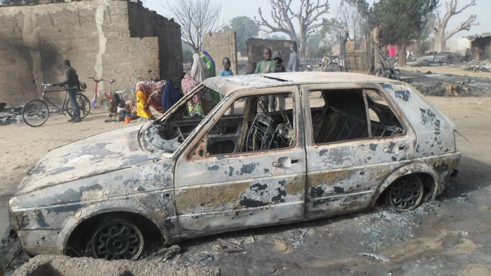 Children gather around a burnt out car following an attack by Boko Haram in Dalori village 5 kilometers (3 miles) from Maiduguri, Nigeria , Sunday Jan. 31, 2016. (AP / Jossy Ola)