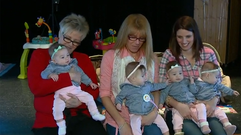 New mother Melina Forget (right) and friends hold Forget's four daughters.