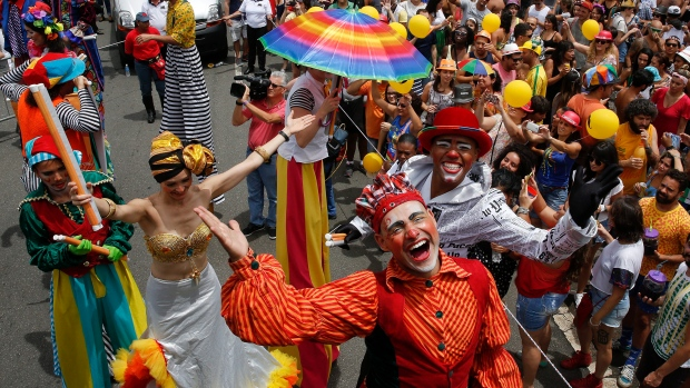 Stilt walkers parade in the Bicho Maluco Beleza street carnival block in Sao Paulo, Brazil, Saturday, Jan. 30, 2016. (AP Photo / Andre Penner)