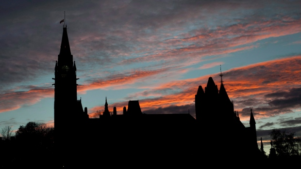 In this file photo, Parliament Hill is seen at sunset on Thursday, Oct. 23, 2014. (Justin Tang / THE CANADIAN PRESS)