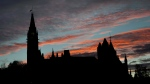 Parliament Hill is seen at sunset on Thursday, Oct. 23, 2014. (Justin Tang / THE CANADIAN PRESS)
