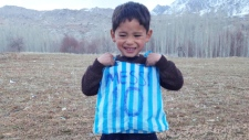 Murtaza Ahmadi in Messi plastic bag jersey